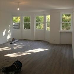 Zur Angebotsübersicht Sanierte 3-Zimmer-Gartenwohnung in München-Solln mit Garage